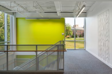 a lime colored wall can serve as a landmark for locating a staircase