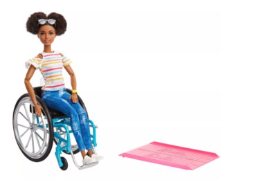 Mattel's black barbie using a wheelchair, along with her very own accessibility ramp.