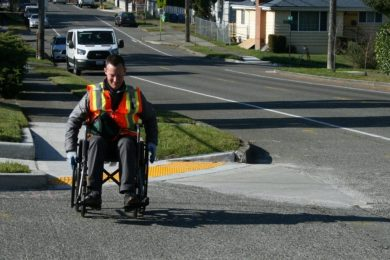 wheelchair user leaving the cross slope to cross the street