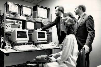In 1988, three Canadian Captioning Development Agency employees watch television monitors in a studio where closed captioning is done.
